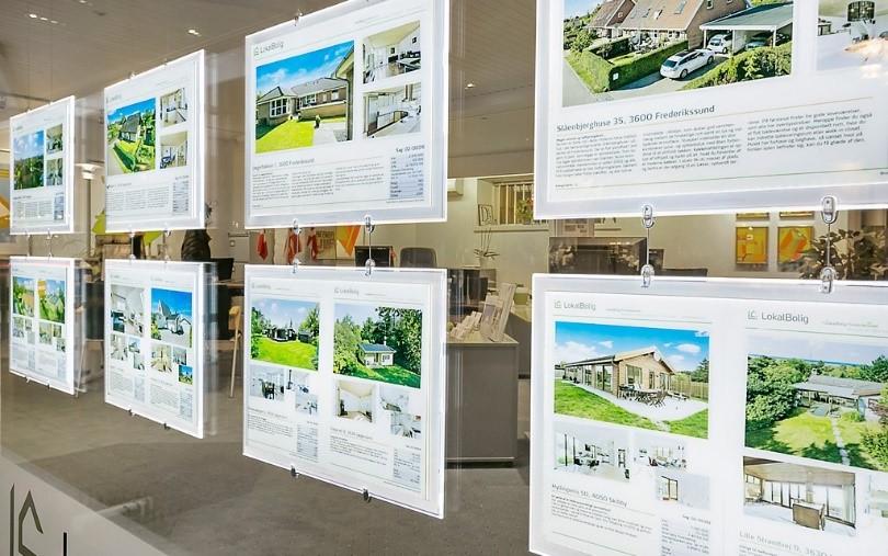 photos illustrant les vitrines d'agences immobilières